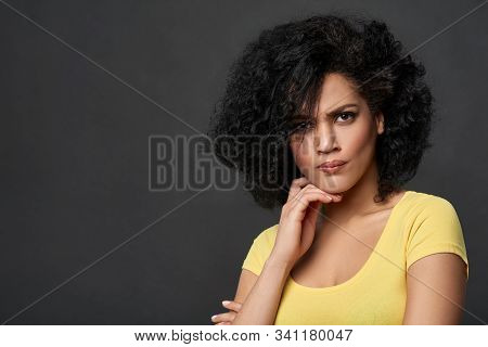 Discontent Frowning Mixed Race Woman Looking At Camera