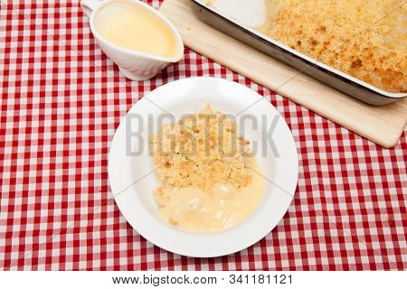 Old Fashioned Homemade Apple Crumble A Bowl Of Traditional British Apple Crumble Served With Custard