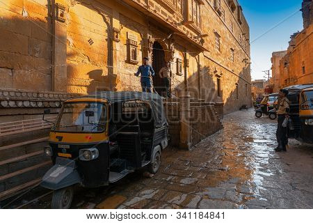 Jaisalmer, Rajasthan,india - October 13, 2019 : Indian Man Washing His Auto With Pipe Water In The M