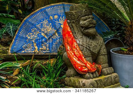 Traditional Asian Decorations In A A Garden, Feng Shui Lion With An Fan And Canvas