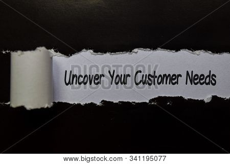 Uncover Your Customer Needs Write On White And Black Torn Paper