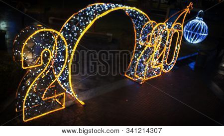 Digits 2020 In Defocus Symbol Of The New Year. Installed Outdoors In A Public Park.