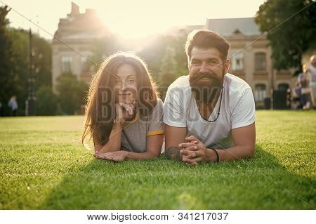 Adding Some Romance. Holiday Romance Of Bearded Man And Sexy Woman. Couple In Love Relaxing On Green