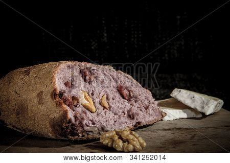 Wine Flavoured Bread (pain Au Vin) With Its Typical Red Inside, Stuffed With Walnuts, On Display On