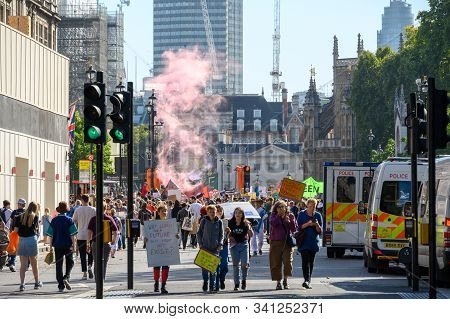 London - September 20, 2019: Red Smoke Released In Parliament Square, London At An Extinction Rebell