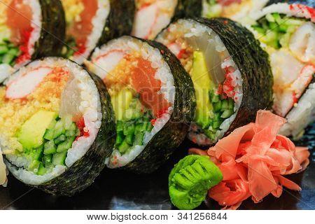 Fresh Sushi With Cucumber Maki, Carrot, Sea Cabbage And Salmon Maki. Japanese Sashimi Sushi Rolls Wi