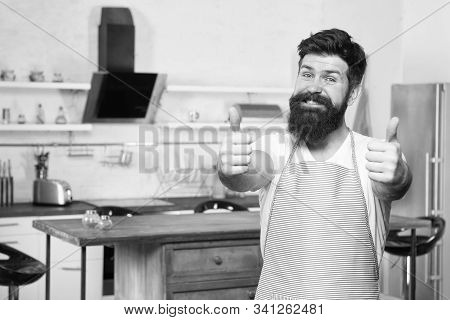 The Best A La Carte Menu. Bearded Male Cook Giving Thumbs Ups And Offering Restaurant Menu. Happy Hi