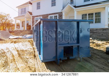 Blu Dumpster, Recycle Waste And Garbage Bins Near New Construction Of Appartment Houses Building