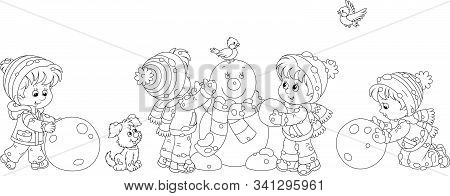 Happy Little Kids Making Big Snow Balls And Sculpting A Friendly Smiling Funny Snowman With A Stripe