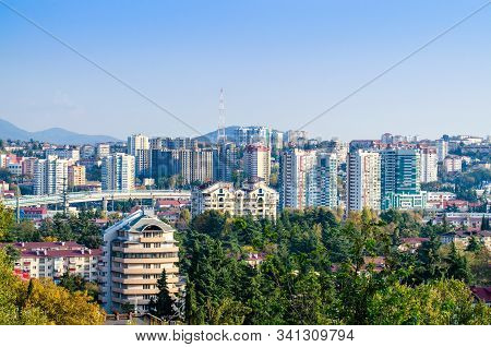 High Residential Buildings On A Background Of Mountains. Beautiful Modern Architecture. Flyover Of T