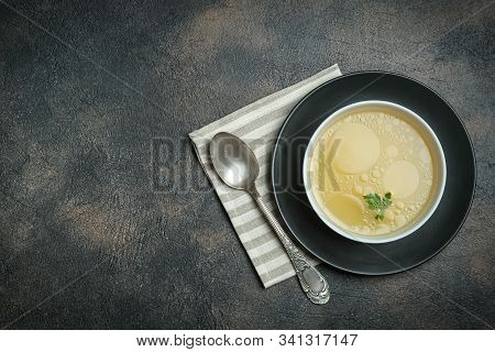 Hearty Lunch. Meat Broth Or Bouillon  From Veal With Breadcrumbs On A Dark Background. Top View. Cop