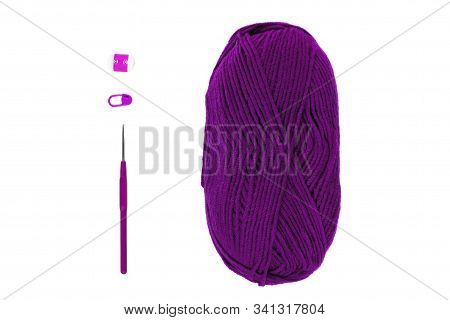Knitting And Crocheting Flatlay.purple Yarn Skein, Crochet Hook, Row Counter On White Background Iso