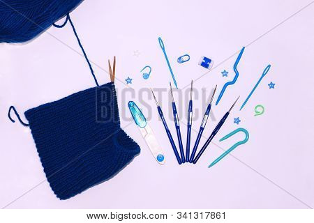 Knitting And Crocheting Flatlay.blue Yarn Skein, Crochet Hook, Row Counter On White Background Isola