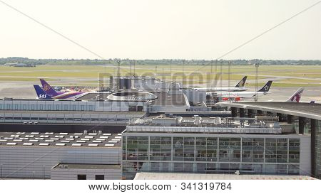 Copenhagen, Denmark - Jul 05th, 2015: Terminal Building With Airplanes Parking At The Gate, Outside