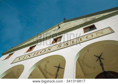 Bento Goncalves, Brazil - July 10, 2019. Painted Pediment And Company Signboard On The Facade Of Sal