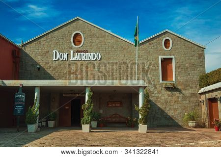 Bento Goncalves, Brazil - July 13, 2019. Rustic Facade Of Don Laurindo Winery Building With The Comp