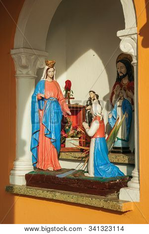 Bento Goncalves, Brazil - July 13, 2019. Statuettes Of Virgin Mary And Saints In Naive Style Made By