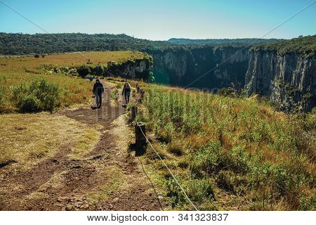 Cambara Do Sul, Brazil - July 16, 2019. Pathway And People At The Itaimbezinho Canyon With Rocky Cli