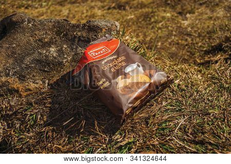Cambara Do Sul, Brazil - July 18, 2019. Biscuits Packaging Upon Stone And Lawn Polluting The Fortale