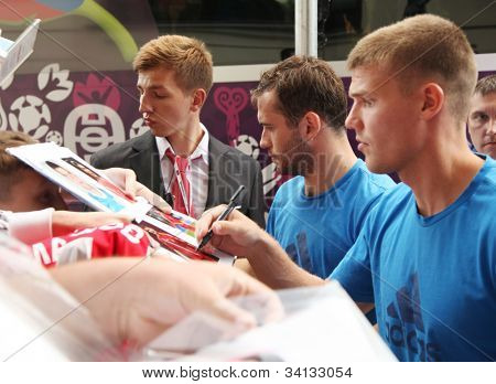 WARSAW, POLAND - JUNE 14: Russian footballers Aleksandr Kerzhakov (Zenit St. Petersburg) and Igor Denisov (Zenit St. Petersburg) are signing autographs, on June 14, 2012 in Warsaw, Poland.