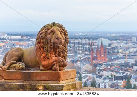 Wiesbaden In Hessen Germany View From Neroberg, In The Foreground A Statue Of A Lion, In The Backgro