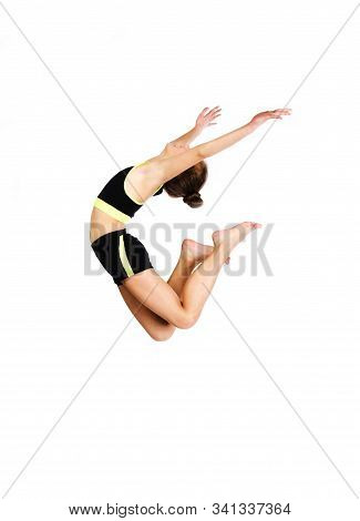 Flexible Cute Little Girl Child Gymnast Jumping And Having Fun Isolated On A White Background. Sport