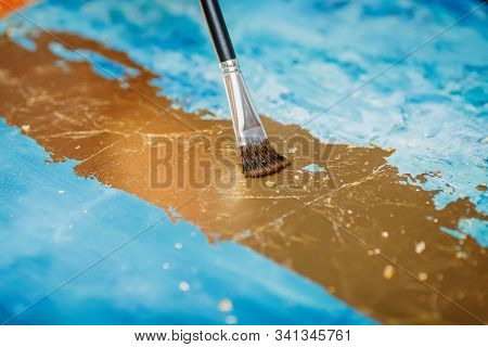 Painting Method With Gold Patina On Blue Background, Closeup