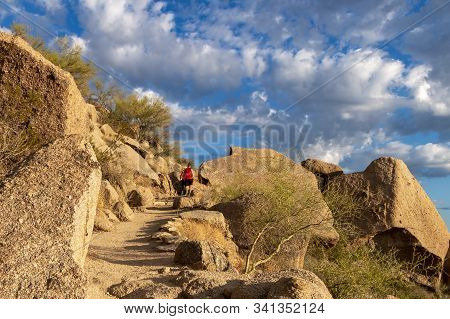 Hikers Heading Up A Desert Trail In The Morning In North Scottsdale Arizona.