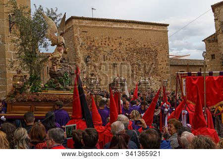Caceres, Spain. April 2019: A Group Of Bearers, Called Costaleros, Carrying A Religious Float