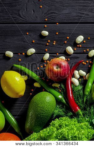 Raw Healthy Food, Grocery Set On A Black Wooden Table