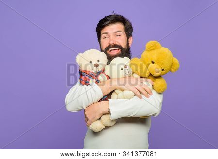 Smiling Man Hugs Teddy Bears Plush Toys. Birthday Or Anniversary. Gift And Present. Holiday. Celebra