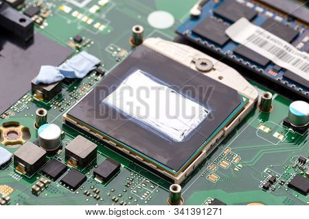 Replacing Thermal Paste On A Laptop. New Thermal Grease On The Processor Close-up.