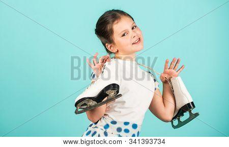 Lets Go Skating. Happy Child With Skates Hanging On Neck. Little Girl Enjoy Ice Skating. Ice Dance.