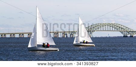 Small Sailboats In The Great South Bay Heading Back To West Islip During A Winter Regatta In Decembe