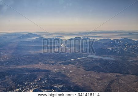 Wasatch Front Rocky Mountain Range Aerial View From Airplane In Fall Including Urban Cities And The