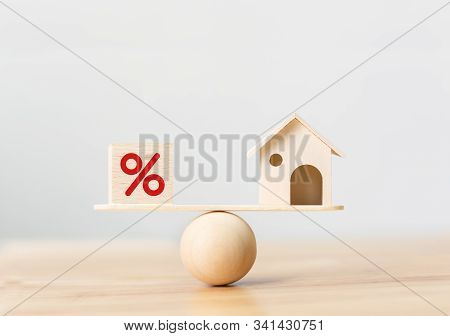 Interest Rate Financial And Mortgage Rates Concept. Wooden Home And Cube Block Shape With Icon Perce