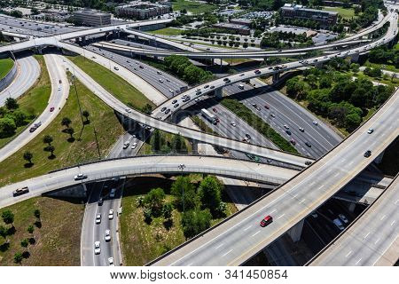 Aerial view of Interstate 85 and Interstate 20 interchange ramps and bridges in Atlanta Georgia.