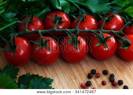 Fresh Vegetables On The Table. Food Background. Close Up. Cherry Tomatoes, A Bunch Of Parsley, Chopp