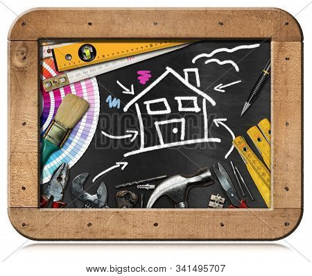 Home Improvement Concept - Work Tools And A Chalk Drawing Of A House In A Black Chalkboard With Wood