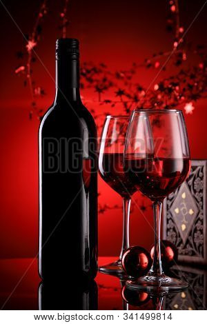 Red Wine Bottle And Glasses With Festive Holiday Feel