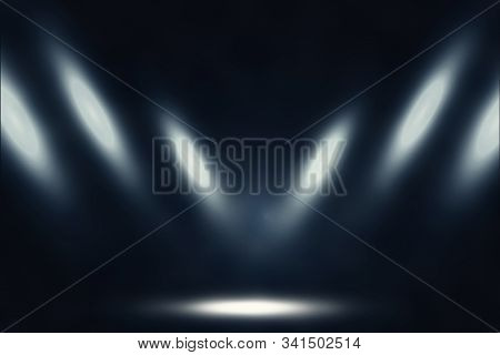 Studio Dark Room Of White Stage With Spot Lighting And Fog In Black Background.