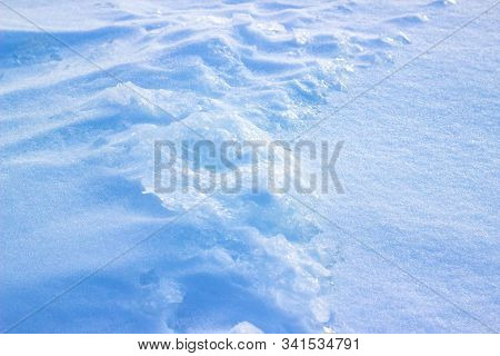 Natural Winter Background With Snow Drifts. Background Of Fresh Snow Texture In Blue Tones. High Ang
