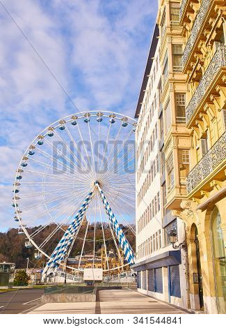 San Sebastian, Spain - December 24, 2019. A Ferris Wheel In The City Of San Sebastian. View From Mir