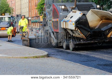 Karlstad, Sweden - June 19, 2019: The Construction Comapany Ncc Laying Asphalt In The City Center.