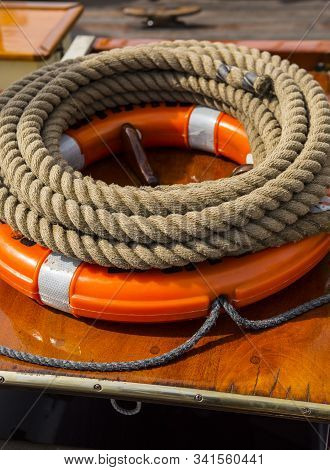 Coiled Ropes And Life Preserver On A Rigged Ship