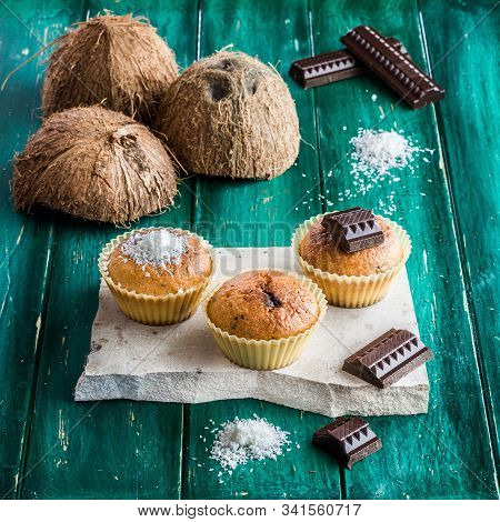 Homemade Coconut Muffins With Chocolate Core On A Green Table