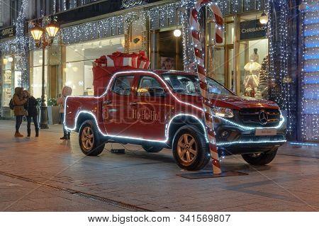Budapest, Hungary - December 08 2019: Christmas Market & Illuminated Car & Tree At Fashion Street. A
