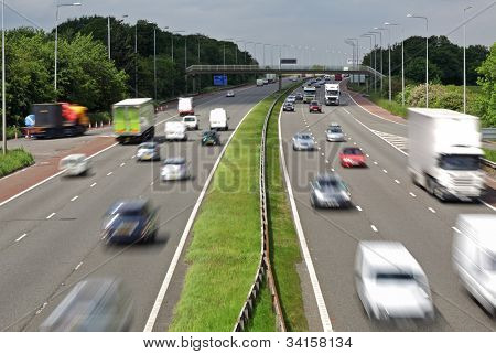 Heavy traffic moving at speed on the M6 motorway in England