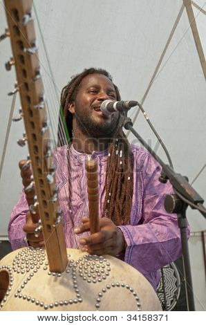 Modou N'Diaye plays the Kora live on the Global Community Stage