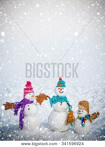 Happy Snowman With Gift Boxes Standing In Winter Christmas Landscape. Funny Snowman With A Carrot In